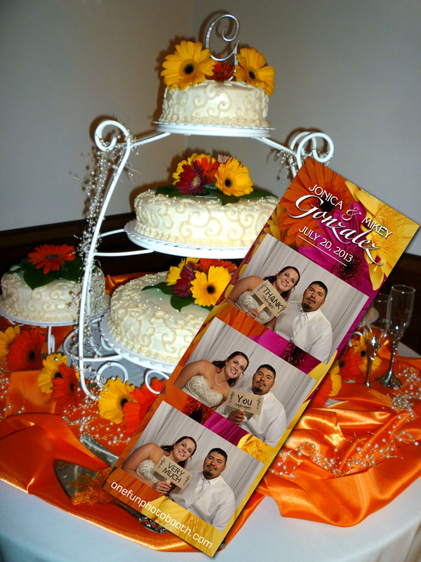 Jonica & Mikey had a gerbera daisy theme as you can tell by their cake. This was carried over into the wedding favor photostrips One Fun Photobooth created.